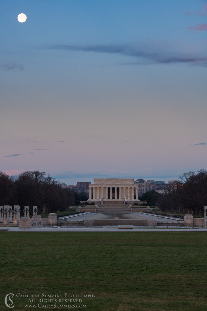Full Moon Sets Over the Lincoln Wemorial and an empty Reflecting Pool: Washington, DC