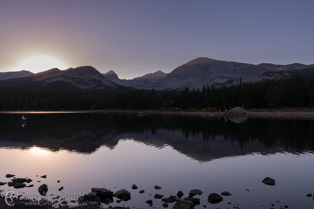 Fisherman in Braninbridge Lake at Sunset on an Autumn Afternoon with Reflection of Mount Audubon and Indian Peaks