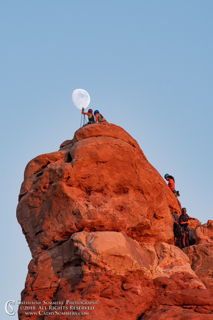 Moon and Climbers: Arches National Park
